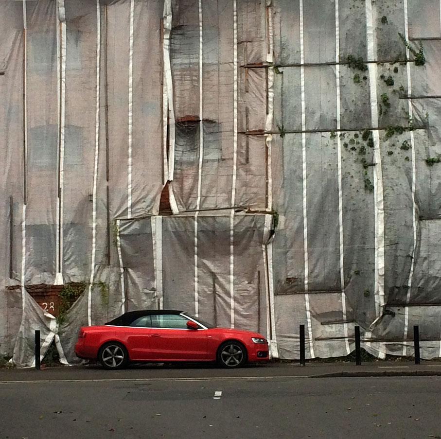 redcarplasticcoveredwall